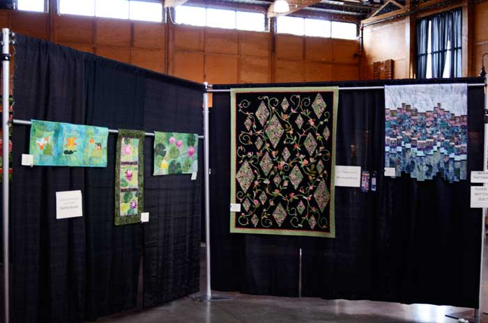 Water Garden series hanging at the main show entrance.