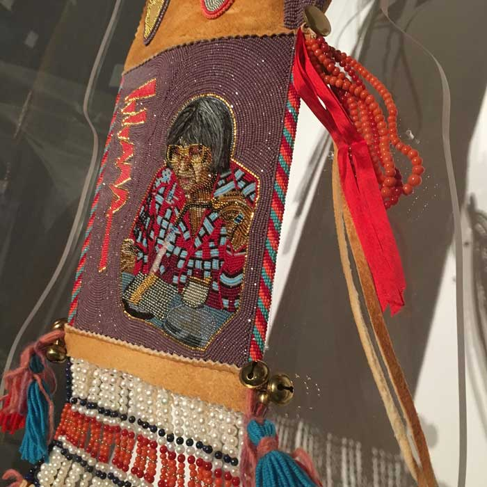 """Artist: Kenneth Williams, JR """"He Was Iconic"""", The piece honors Native jeweler Charles Loloma Glass beads, turquoise, coral, seed pearls, brass, wool, yarn, brain-tanned hide, gold, human hair"""
