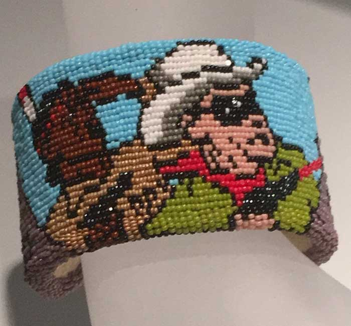Artist: Marcus Amerman Lone Ranger and Tonto bracelet Glass beads, thread, rubberized cotton, leather and brass