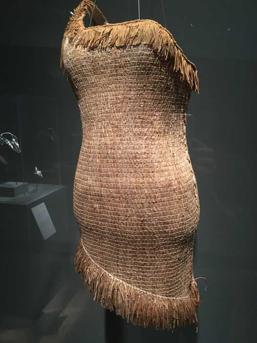 "Artist: Lisa Telford ""PochaHaida Dress"" Red cedar bark, cordage, and faux-leather fringe"